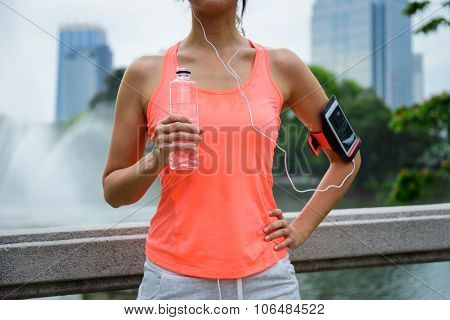Woman Drinking Water During Outdoor Fitness Workout