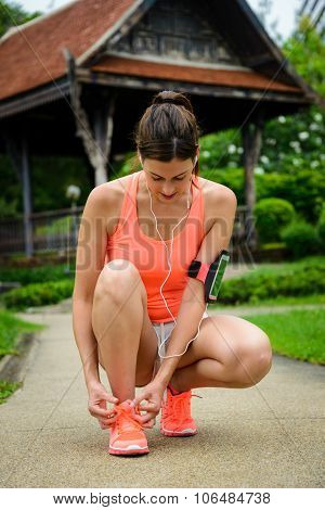 Sporty Woman Getting Ready For Running At City Park