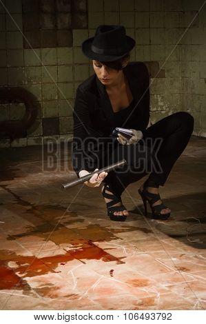 Criminalist Investigating The Crime Scene