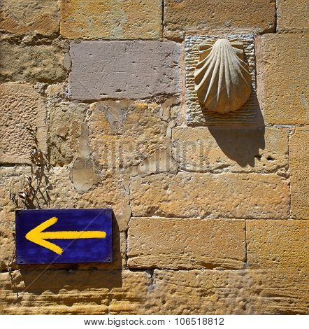 The way of Saint James arrow and shell sign at Granon in La Rioja Logrono