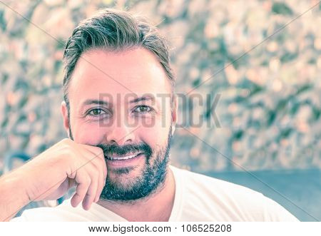 Portrait Of A Young Handsome Man With A Candid Natural Smile - Concept Of Sincerity And Reliability