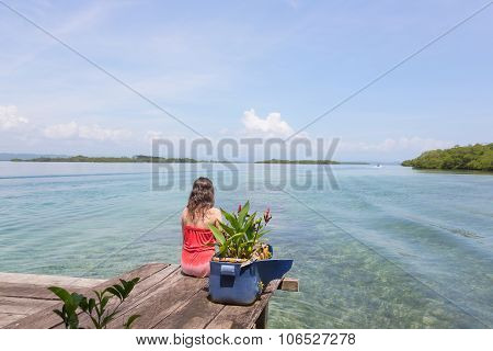 Woman at the edge of pier