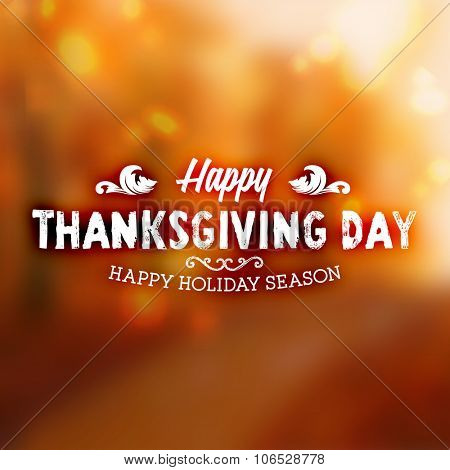 Thanksgiving Day Holiday Typographic Design. Calligraphic Elements. Blurred Autumn Forest Background.