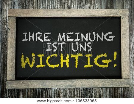 Your Opinion is Important to Us (in German) written on chalkboard poster