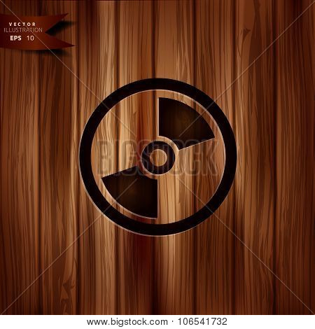 Compact disk web icon, musical CD. Wooden texture.