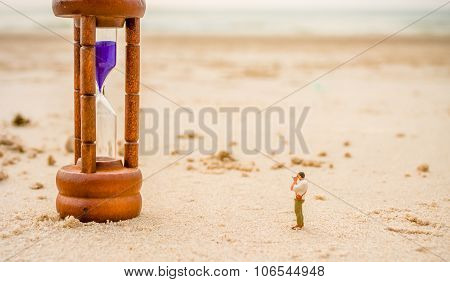 Mini Figure Dolls Photographer Take Picture On Sandglass