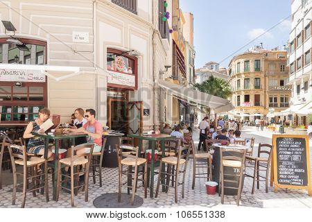 People Eating Outdoors In A Restaurant In Malaga
