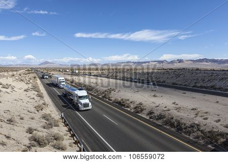 MOJAVE DESERT, CALIFORNIA, USA - October 6, 2015:  Constant truck and tourist traffic in Interstate 15 between Los Angeles and Los Vegas in California's Mojave Desert.