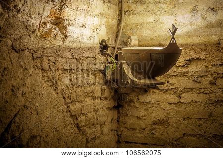 Old Cript Or Basement Textured Wall With Electrical Wires In The Corner And An Antique Metal Vintage