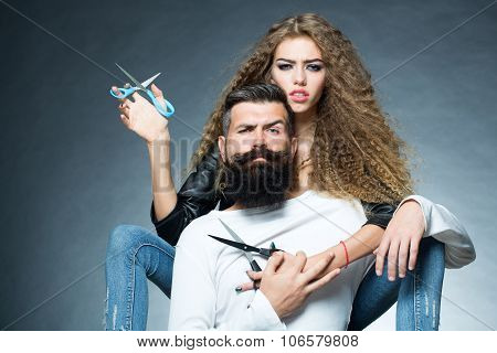 Portrait Of Couple With Scissors