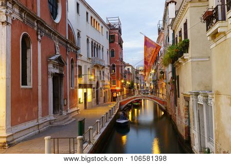 VENICE, ITALY - SEPTEMBER 14, 2014: Venice at evening. Venice is a city in northeastern Italy sited on a group of 118 small islands separated by canals and linked by bridges