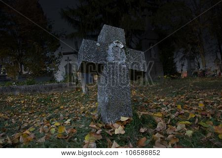 Spooky Leaning Cross Tomb Stones In A Dark Autumn Scene At Night. Old Scary Graves In The Cemetery.