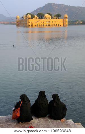 Muslim Women Sitting On The Shore Of Man Sagar Lake In Jaipur, India.