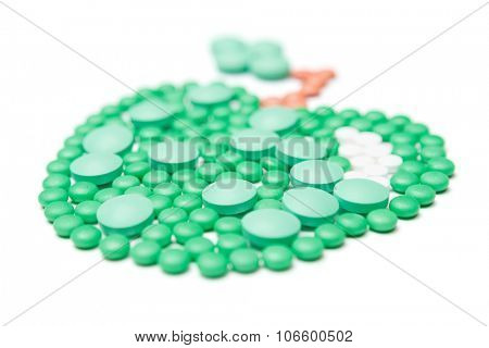 Green tablets, isolated. Healthcare concept