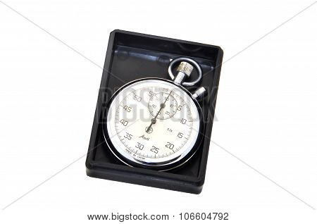 Stopwatch in a black box with a cover on a white background
