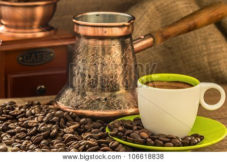 Fresh Coffee With Turkish Coffee Pot At Roasted Bio Coffee Beans And Old Wooden Manual Coffee Grinde