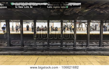 People Wait At Subway Station Wall Street