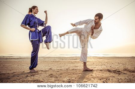 Couple Training Martial Arts Techniques In The Morning