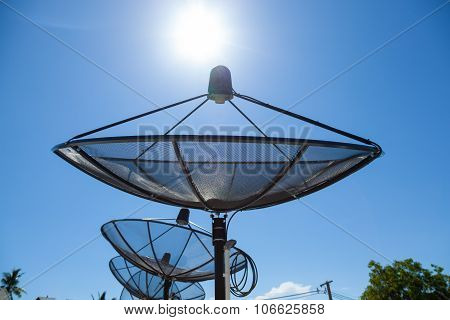 Satellite dishes Mounted on the rooftop of the building. Satellite TV Receiver ** Note: Shallow depth of field