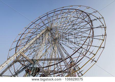 big bare structure of ferris wheel in theme park Pushkar India poster
