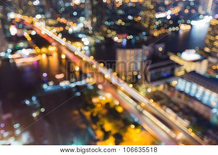 Abstract blurred lights city bridged cross river at night
