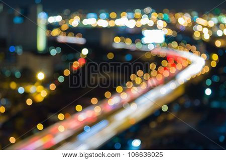 Blurred bokeh light city downtown highway curved at night
