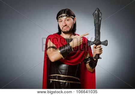 Roman warrior with sword against background