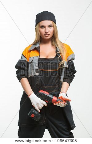Young sexy female holding a cordless screwdriver