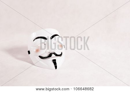 white anonymous mask on white background, hacking movement