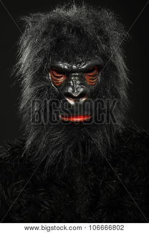 Portrait of a man with gorilla costume