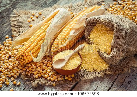 Corn Groats And Seeds, Corncobs On Wooden Rustic Table.