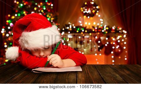 Christmas Child Write Letter To Santa Claus, Kid In Santa Hat Writing Wish List