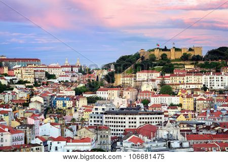 Lisbon, Portugal, View To The Alfama Quarter And St. Jorge Castle At Sunset