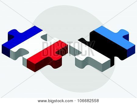 France and Estonia Flags in puzzle isolated on white background poster