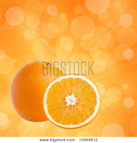 One And Half Oranges On Abstract Bokeh Background