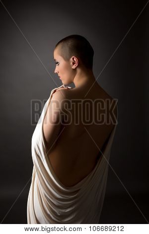Back view of defenseless woman with shaved head