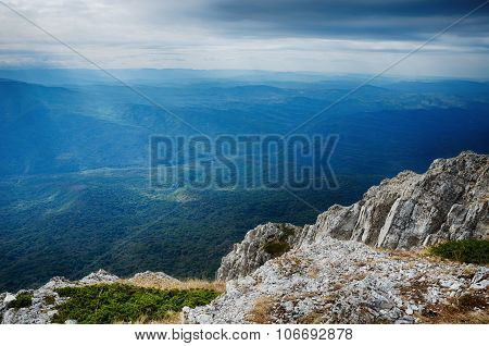 View From A High Cliff On The Forest And Mountains