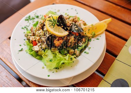 traditional slovenian and croatian seafood salad with fresh mussels poster