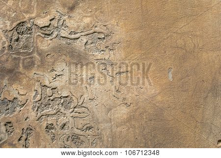 old weathered concrete wall with damages and cracks texture background