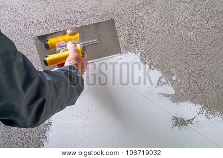 Construction Worker - Plastering And Smoothing Concrete Wall With White Cement By A Steel Trowel - S