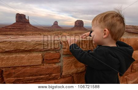 Child Looking At Monument Valley