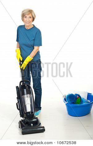 Senior Woman Using Vacuum Cleaner