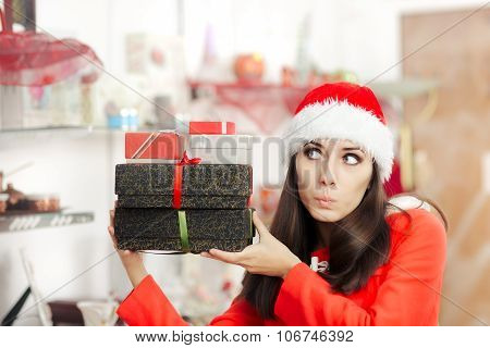 Curious Christmas Girl with Presents in Gift Shop