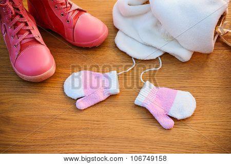 Children's winter clothes: warm pink jacket, hat, scarf, mittens, boots