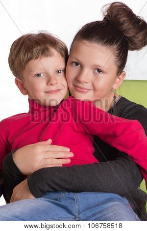 The boy sat in a lap at the girl embraced poster