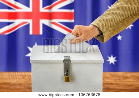 Man Putting A Ballot Into A Voting Box - Australia