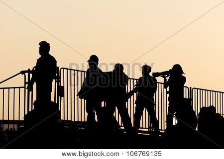 Silhouette Of Group Photographer