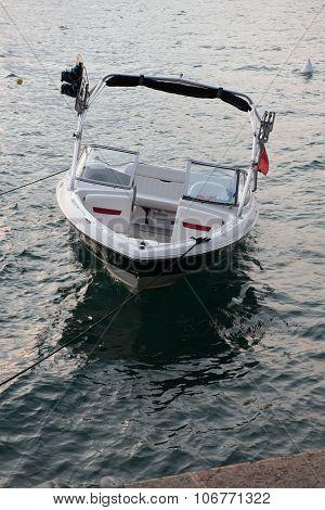 Powerboat Swinging On The Waves At Lake Garda