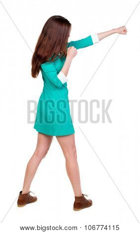 skinny woman funny fights waving his arms and legs. Rear view people collection.  backside view of person.  Isolated over white background. Girl in aqua dress beats hand.