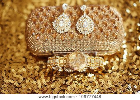 Womens Accessories. Fashion Diamond Earrings And Golden Wristwatch. Sparkling Jewelry Shiny Crystal